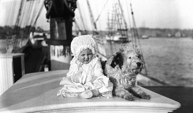 Baby and a dog on a sailing ship