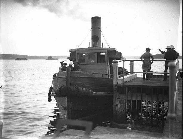 Tug docked at a wharf in Bradleys Head