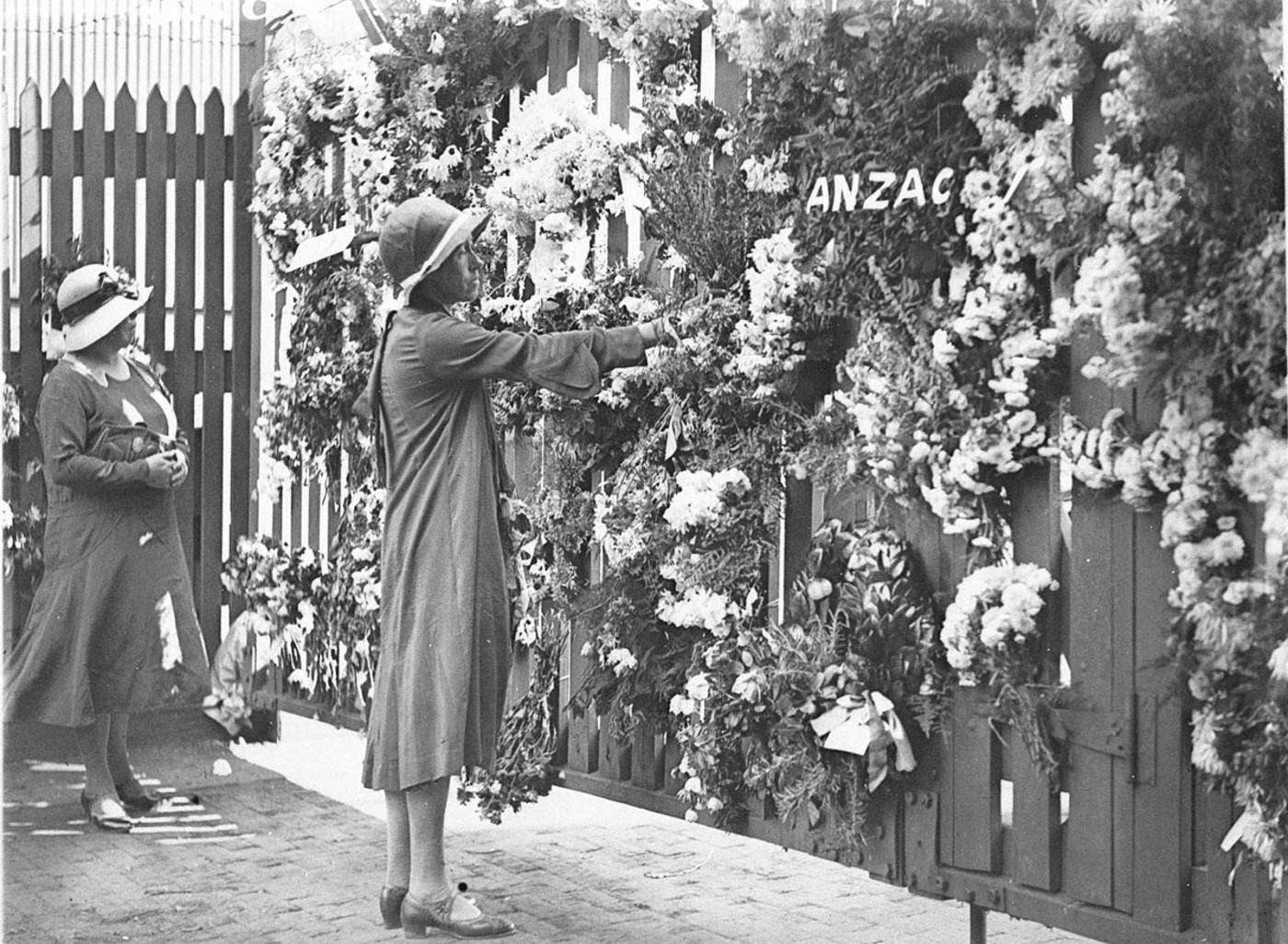 Women lay wreaths