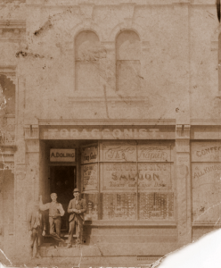Sepia photograph of tobacconist saloon
